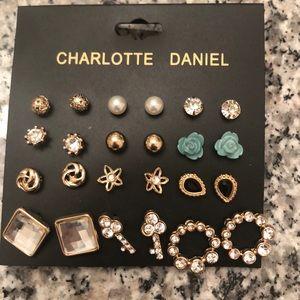 Set of 12 Charlotte Daniel Gold tone earrings.